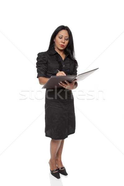 Businesswoman - Latina writing in notepad Stock photo © dgilder