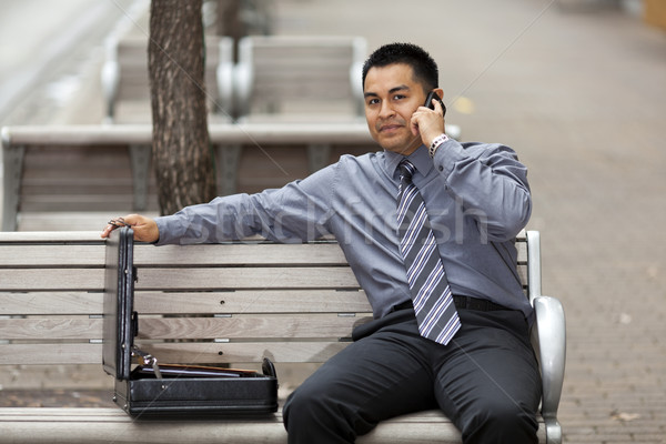 Сток-фото: Hispanic · бизнесмен · говорить · сотового · телефона · складе · фото