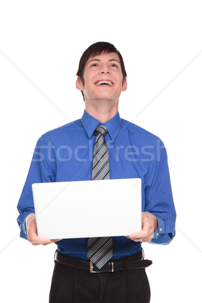 Expressions - Caucasian businessman laughing out loud at his com Stock photo © dgilder
