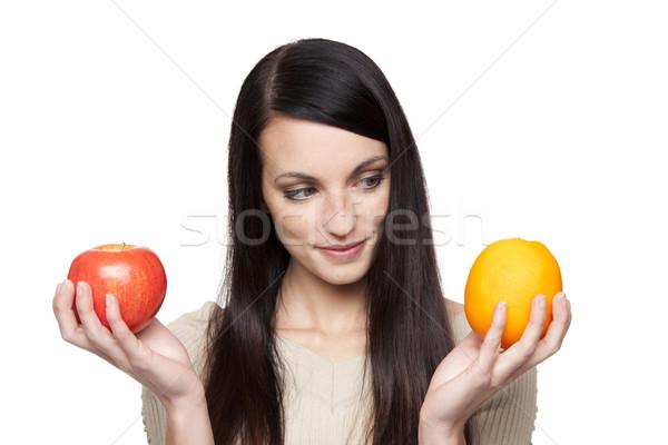 Produzir maçãs laranjas mulher isolado Foto stock © dgilder