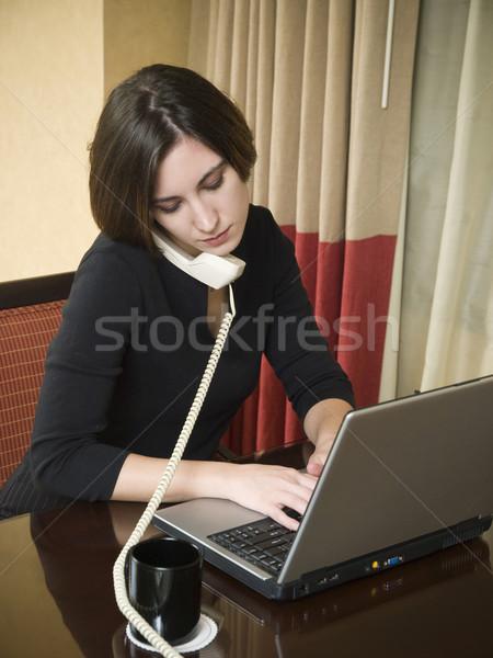 Iş gezisi dizüstü bilgisayar işkadını telefon çalışma dizüstü bilgisayar Stok fotoğraf © dgilder
