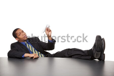 businessman - bored paper airplane Stock photo © dgilder