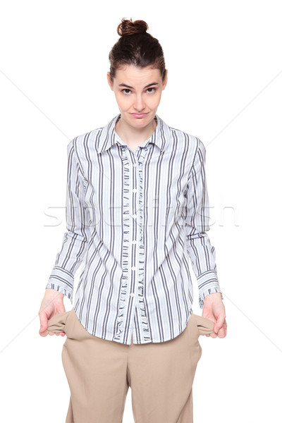 Poor - woman standing with turned out empty pockets Stock photo © dgilder