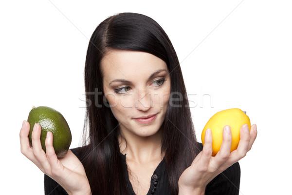 Produce - limes to lemons woman Stock photo © dgilder
