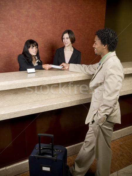 hotel - business traveler Stock photo © dgilder