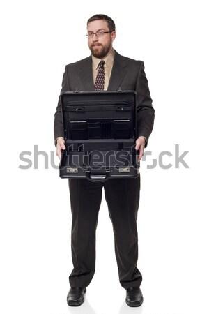 Front view Caucasian businessman holding open briefcase showing Stock photo © dgilder