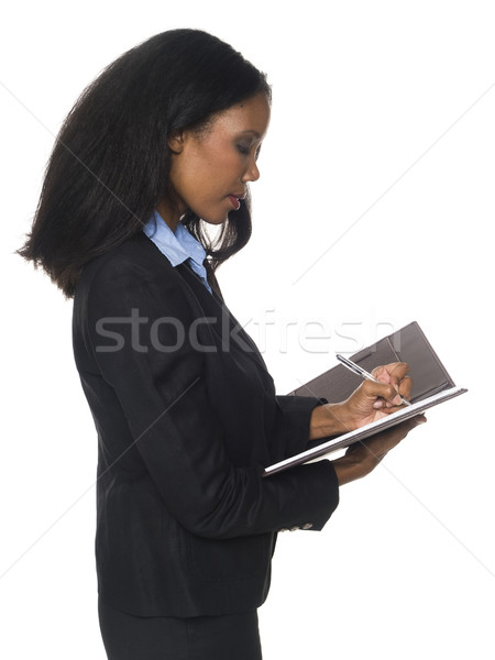 businesswoman - writing on notepad Stock photo © dgilder