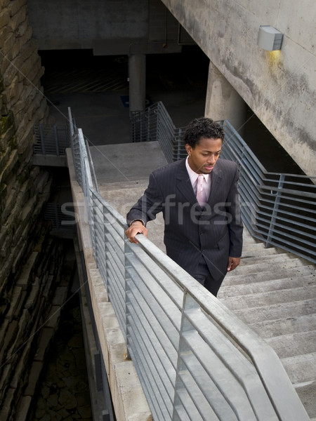 Empresário escalada escada edifício moderno urbano preto Foto stock © dgilder