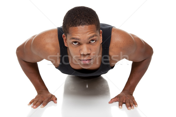 Izmos férfi fekvőtámasz izolált stúdiófelvétel Stock fotó © dgilder