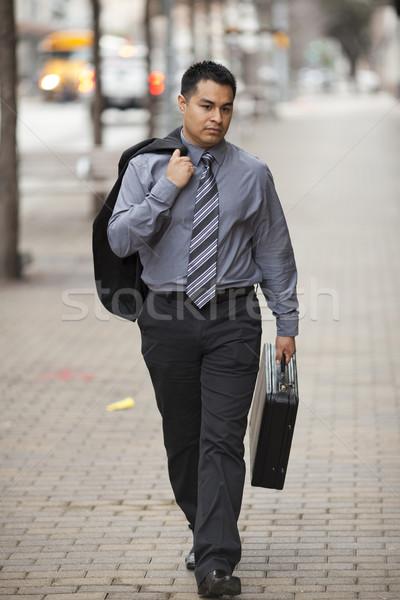 Hispanic Businessman - Walking Downtown With Briefcase Stock photo © dgilder
