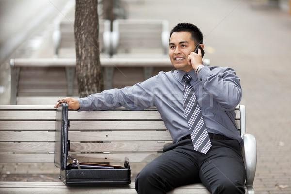 Hispanic бизнесмен говорить сотового телефона складе фото Сток-фото © dgilder