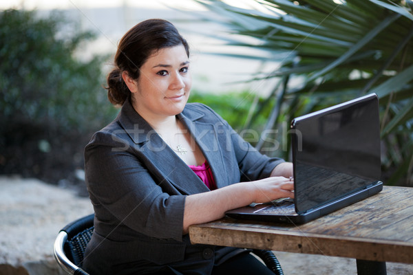 Businesswoman - Telecommuting from Internet Cafe Stock photo © dgilder