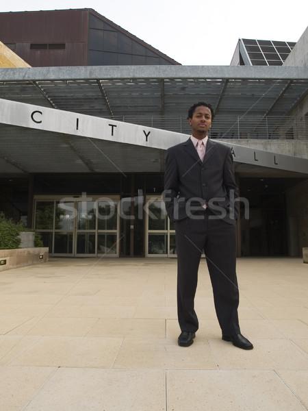 Empresário cidade ouvir edifício moderno urbano preto Foto stock © dgilder