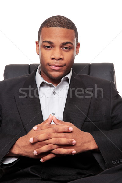 Young African American businessman relaxing in chair Stock photo © dgilder