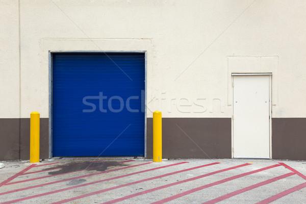 Hátterek fal garázs ajtó nagy épület Stock fotó © dgilder