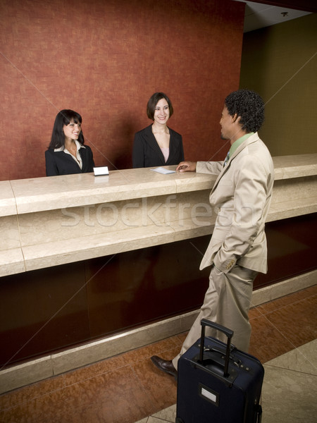 hotel - business traveler Stock photo © dgilder