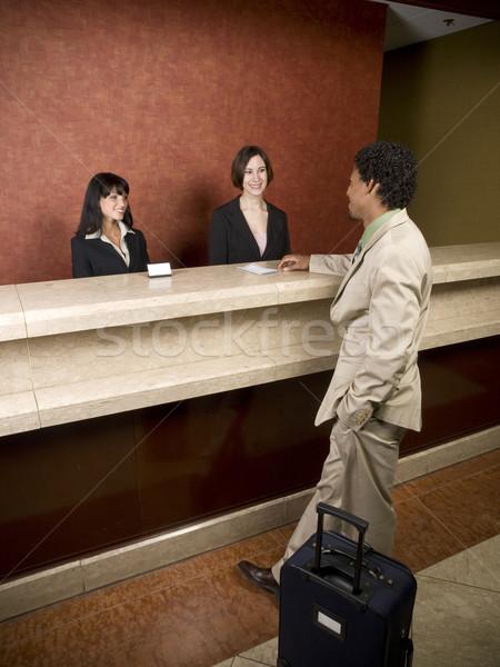 Hotel negócio viajante empregado sorrir trabalhando Foto stock © dgilder