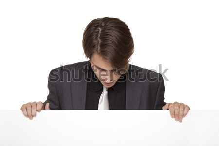 businessman - lookind down blank sign Stock photo © dgilder