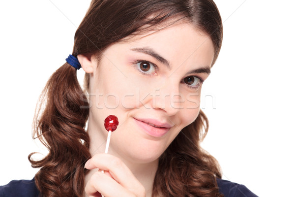 Young adult woman in pigtails with lollipop Stock photo © dgilder