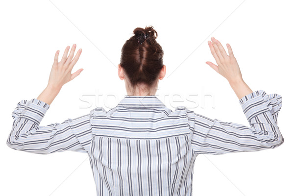 Robbery stickup - Caucasian woman holding hands in air rear view Stock photo © dgilder