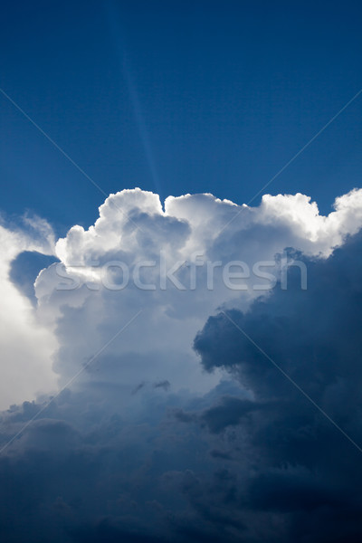 Sunbeam through building thunderstorm - cumulonimbus clouds Stock photo © dgilder