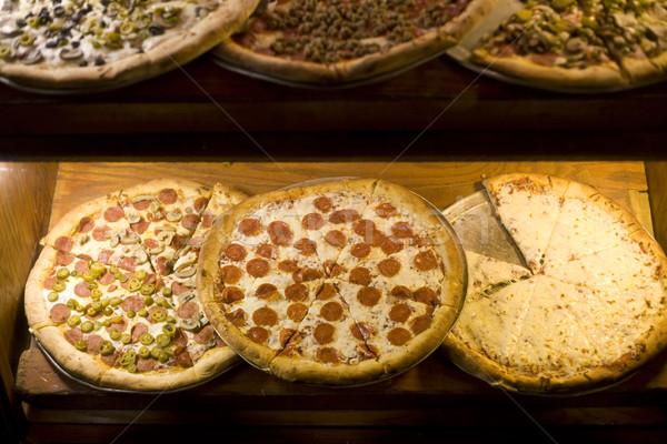 Pizzeria pizza plakje venster vers Stockfoto © dgilder