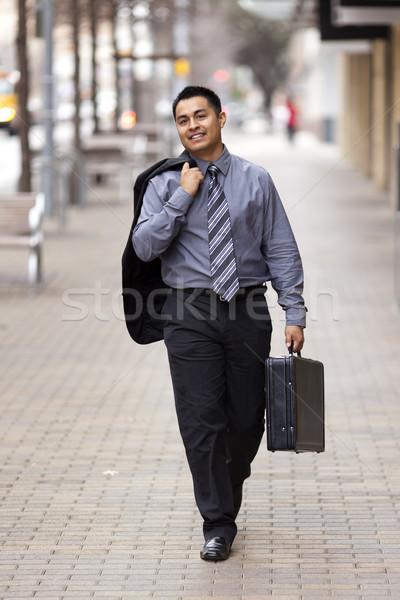 Hispanos empresario caminando centro de la ciudad maletín stock Foto stock © dgilder