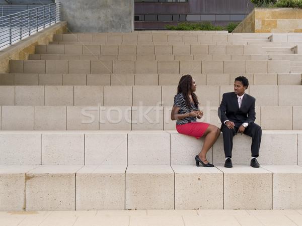 Negócio discussão empresário empresária sessão edifício moderno Foto stock © dgilder