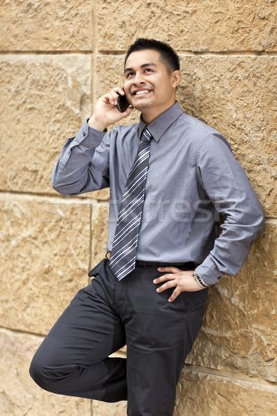 Latino zakenman muur voorraad foto Stockfoto © dgilder