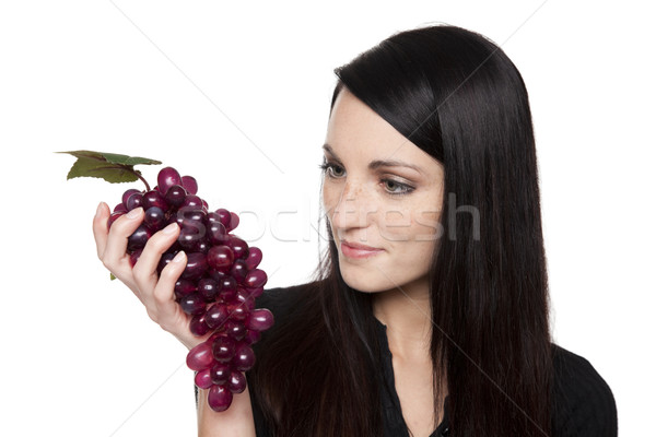 Produce - fruit woman with red grapes Stock photo © dgilder