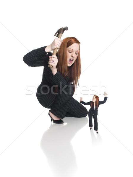Kobieta interesu pokonać odizolowany młotek metafora Zdjęcia stock © dgilder