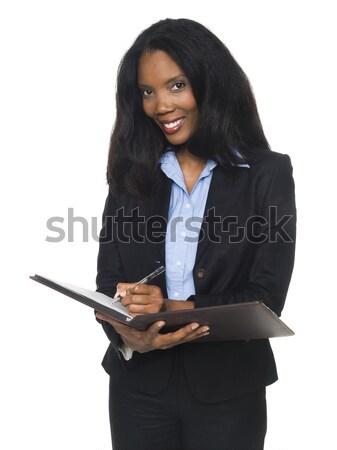 businesswoman - writing on notepad Stock photo © dgilder