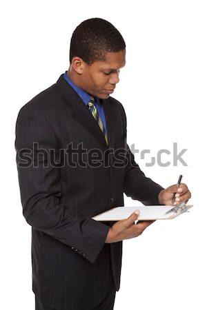 üzletember vágólap kérdőív izolált stúdiófelvétel tömés Stock fotó © dgilder