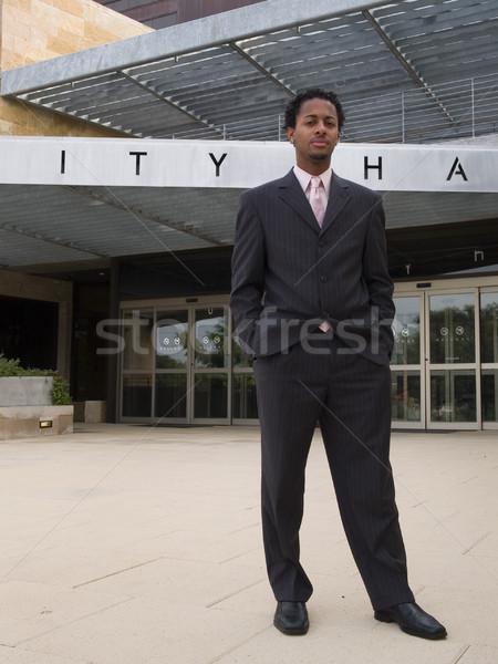 Empresário cidade ouvir moderno edifício Foto stock © dgilder