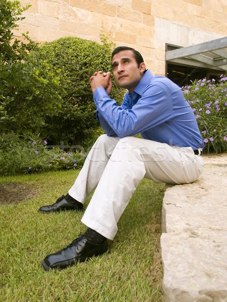 Spanyol üzletember ül kő jóképű kívül Stock fotó © dgilder