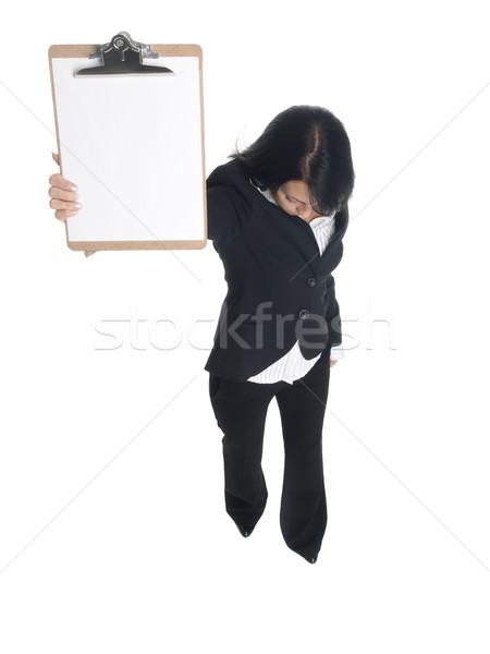 Empresária clipboard isolado olhando para baixo Foto stock © dgilder
