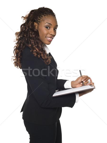 üzletasszony jegyzetel izolált stúdiófelvétel ír jegyzettömb Stock fotó © dgilder