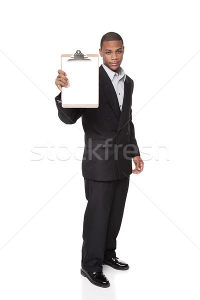 Africano americano empresário isolado branco clipboard Foto stock © dgilder
