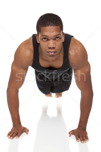 muscular man pushups Stock photo © dgilder