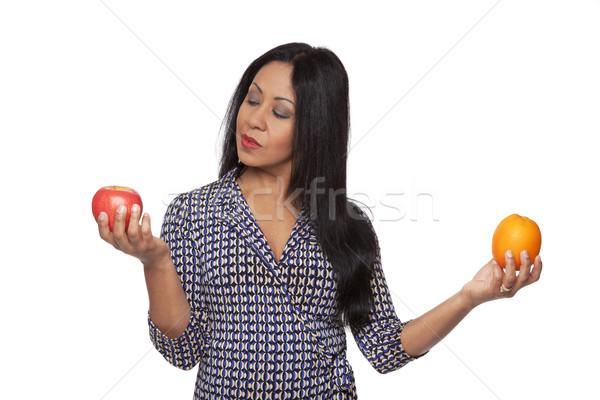 случайный яблоко оранжевый изолированный женщину Сток-фото © dgilder
