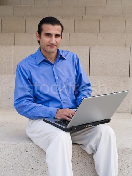 Hispânico empresário laptop bonito surfe internet Foto stock © dgilder