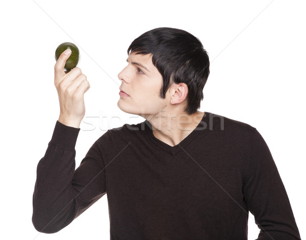 Caucasian man examining a lime Stock photo © dgilder