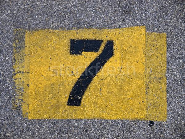 backgrounds - parking lot number Stock photo © dgilder