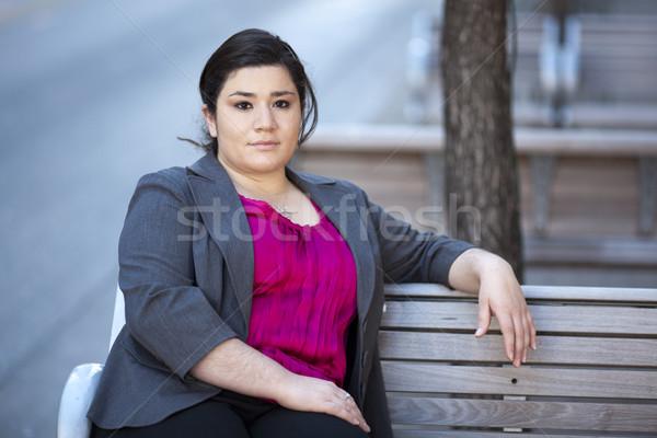 Femme d'affaires détente banc stock photo Photo stock © dgilder