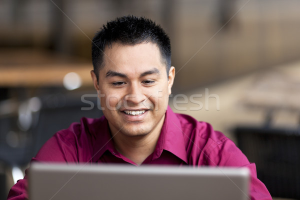 Hispanic Businessman - Telecommuting from Internet Cafe Stock photo © dgilder