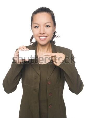 деловая женщина изолированный улыбаясь указывая новых Сток-фото © dgilder