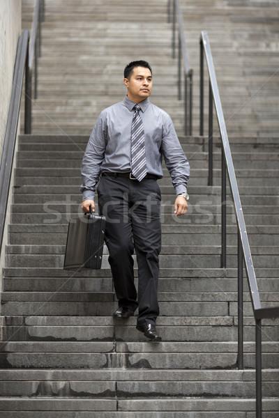 Hispanic бизнесмен ходьбе вниз лестница складе Сток-фото © dgilder