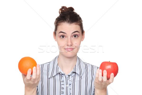 Sötét nő választ alma narancs izolált Stock fotó © dgilder