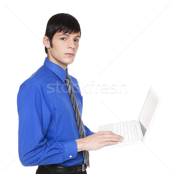 Caucasiano empresário em pé computador portátil isolado Foto stock © dgilder