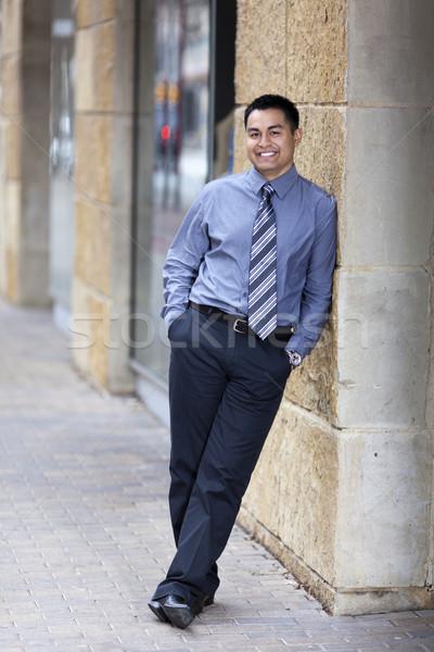 Latino zakenman stenen muur voorraad foto Stockfoto © dgilder